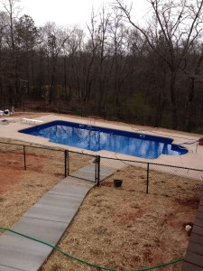 Vinyl liner pool, fencing, and retaining wall